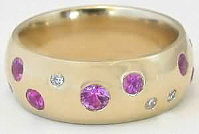 Custom designed pink sapphire wide band from MyJewelrySource