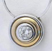 Bezel Set Diamond Solitaire Pendant in 14k white and yellow gold