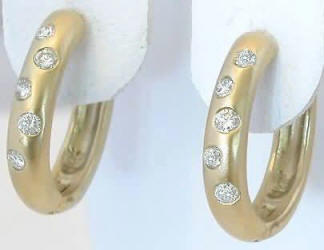 0.15 ctw Burnished Diamond Oval Hoop Earrings in 14k yellow gold