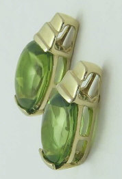 2.6 ctw Oval Faceted Buff Top Peridot Earrings in 14k Yellow Gold