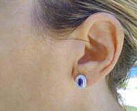 Bezel Set Oval Blue Sapphire Earrings with Diamond Halo in 14k white gold