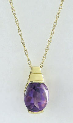 1.3 carat Buff Top Oval Amethyst Pendant in 14k yellow gold