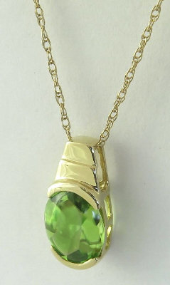 1.3 carat Buff Top Oval Peridot Pendant in 14k yellow gold