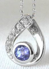 Natural Bezel Set Tanzanite and Diamond Pendant in 14k white gold