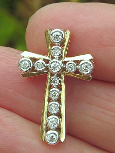 Men's and Woman's Diamond Cross Pendants in 14k white or yellow gold. Only Real Diamonds.