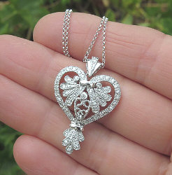 Real Diamond Heart Pendants set in 14k Gold for sale. Many Unique Styles for sale