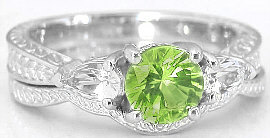 peridot 3 stone engagement ring in 14k white gold