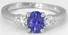 Oval Tanzanite and Round Diamond Ring with Engraving in 14k white gold