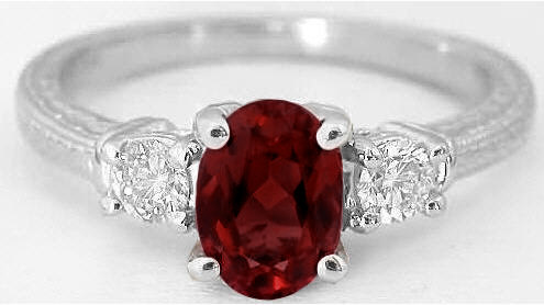 Garnet And Diamond Ring With Three Stone Styling And