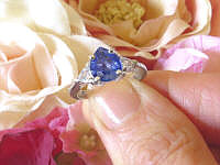 Pear Cut Ceylon Blue Sapphire and Trillion White Sapphire Three Stone Engagement Ring in 14k white gold