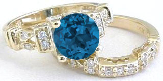 London Blue Topaz and Diamond Engagement Ring in 14k yellow gold