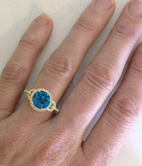 Round London Blue Topaz And Diamond Halo Ring In 14k