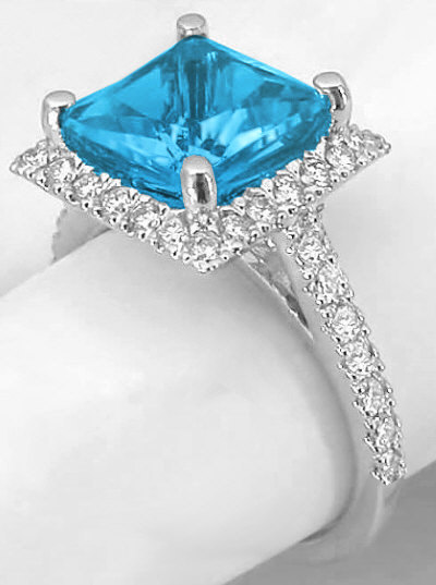 princess cut blue topaz and halo ring in 14k white