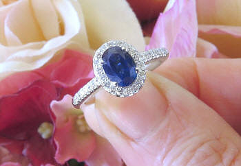 Natural Oval Blue Sapphire Engagement Ring with a Genuine Diamond Halo in 14k white gold for sale