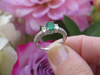 Vintage Style Natural Emerald Engagment Ring in 14k white gold. Oval side Diamonds.