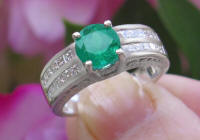 Natural Round Emerald Engagement Ring in solid 18k white gold for sale