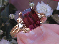 Buy a Large Emerald Cut Rhodolite Garnet Ring with Rope Design in solid 14k real yellow gold for sale