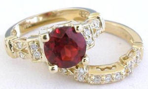 Garnet and Diamond Engagement Ring in 14k yellow gold