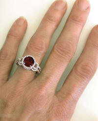 Garnet Engagement Ring and Wedding Band on the hand