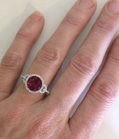 Checkerboard Faceted Rhodolite And Diamond Halo Engagement