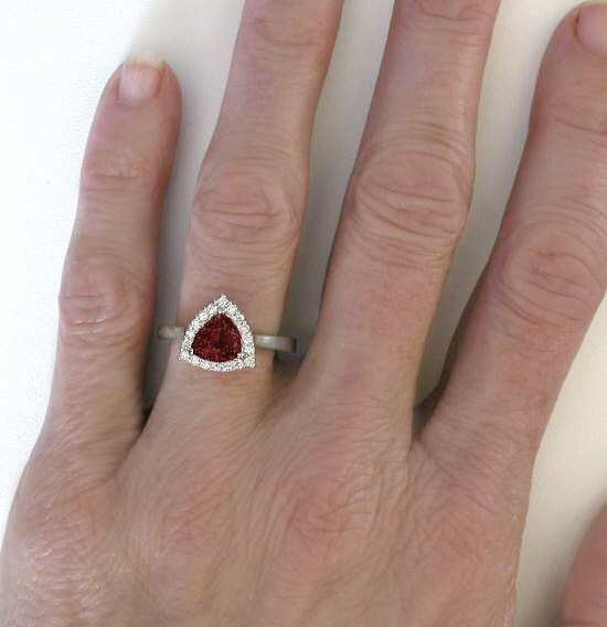 Trillion Cut 7mm Garnet In A Diamond Halo Ring Mounting