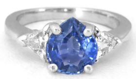 Pear Cut Ceylon Blue Sapphire and Trillion White Sapphire Three Stone Ring for sale