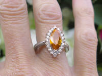 4 carat Natural Marquise Orange Sapphire Ring with a real Diamond Halo with a  solid 14k white gold band for sale