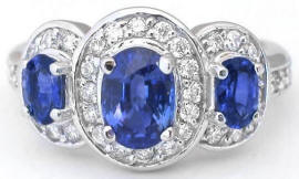 Dramatic Ceylon Oval Sapphire and Diamond Ring in 14k white gold
