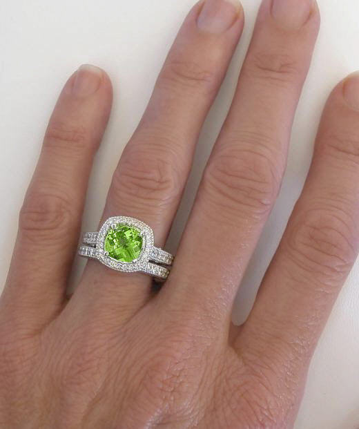 cushion cut peridot and diamond halo engagement ring on the hand - Peridot Wedding Rings