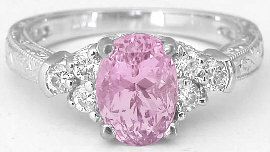 Light baby pink sapphire engagement ring - looks like a pink diamond