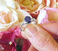 Natural Oval Blue Sapphire and Trillion White Sapphire Three Stone Engagement Ring in 14k white gold