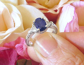 Natural Oval Royal Blue Sapphire and Trillion White Sapphire Engagement Ring in 14k white gold for sale