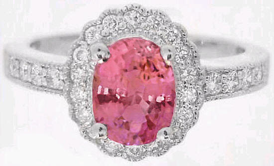 Oval Peachy Pink Sapphire And Scalloped Diamond Halo