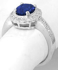 Exceptional Ceylon Intense Blue Sapphire and Diamond Halo Ring in Platinum