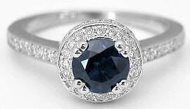 Round Cut Sapphire and Diamond Ring in 14k white gold
