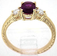 Three Stone Magenta Sapphire and Diamond Ring in 14k Gold