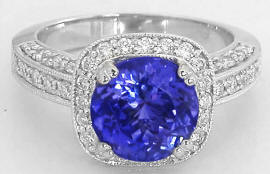 Round Tanzanite and Diamond Halo Ring in 14k white gold