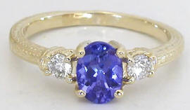 3 Stone Oval Tanzanite Round Diamond Ring in 14k yellow gold