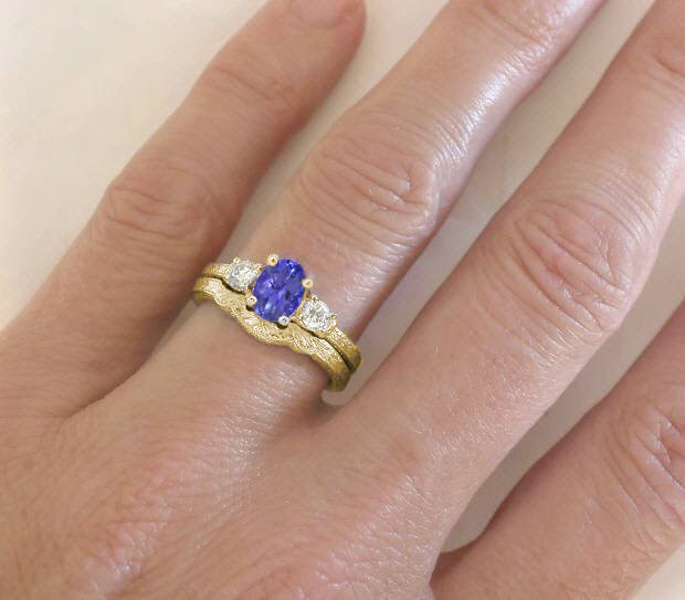 tanzanite and diamond engagement ring and matching wedding