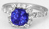 Cushion Tanzanite and Diamond Halo Ring in 14k white gold