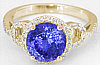 3.19 ctw Round Tanzanite and Diamond Halo Ring in 14k yellow gold