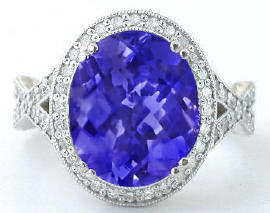 oval tanzanite ring with hand engraving