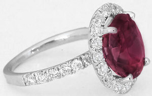 Large Pink Sapphire and Diamond Halo Engagement Ring