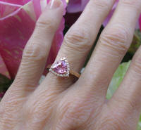 Rose gold natural trillion cut pink sapphire wedding ring with a real diamond halo