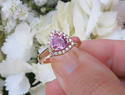 Rose gold natural trillion cut pink sapphire engagement ring with a real diamond halo for sale