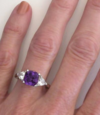Hand Picture of Cushion Amethyst and Trillion White Sapphire Ring in 14k white gold