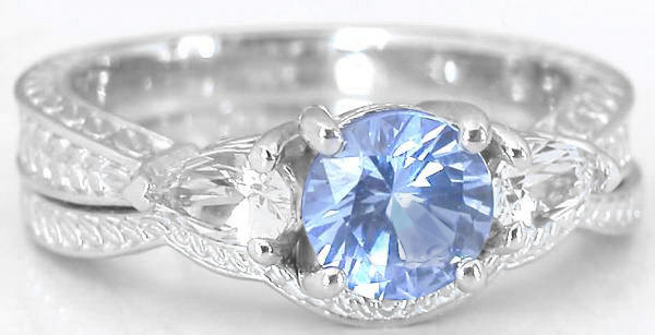 blue and white sapphire engagement ring with carved band