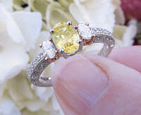 Platinum Oval Natural Yellow Sapphire Engagement Ring with Real Side Diamonds in 14k white gold for sale