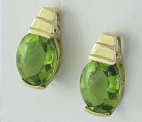 3.0 ctw Oval Faceted Buff Top Peridot Earrings in 14k Yellow Gold