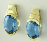 3 ctw Oval Faceted Buff Top Blue Topaz Earrings in 14k Yellow Gold